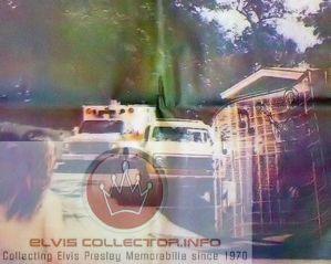 WMM 1977 August 16 ambulance leaving Gracelnad with woodpnael truck