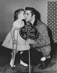 1957 Elvis bending down little girl kissing him March of Dimes