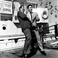 Elvis with Danny Thomas St. Jude legs extended