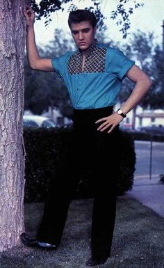 1968 Elvis standing by tree unique look blue shirt black pants colorized