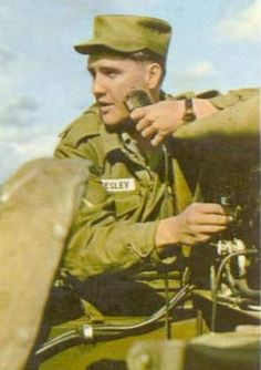 ARMY colorized with Elvis working some type of electronic equipment
