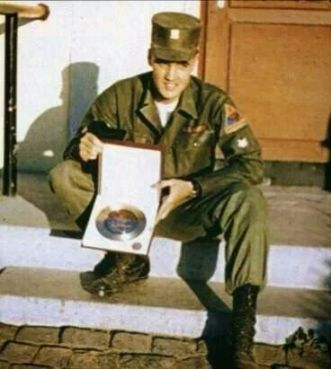 ARMY Elvis sitting on steps front house holding a gold or platium record GREAT RARERERRERER
