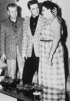 BIO Army induction Elvis with Gladys and Vernon full length his hand lovingly Gladys back head