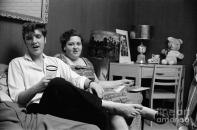 BIO 1956 Elvis with Gladys Ep holding glass and shoes off feet JUST like mine Gladys happy