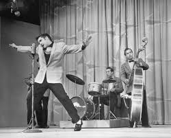 WILD ELvis onstage 1956 sullivan side shot