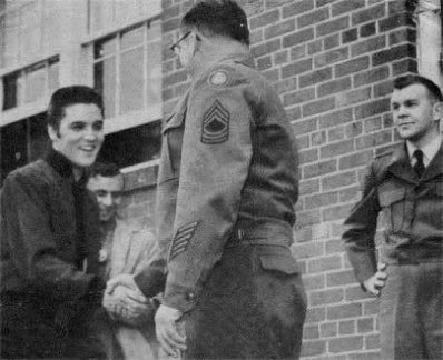1957 candid Elvis shaking hands outside Army registration Memphis
