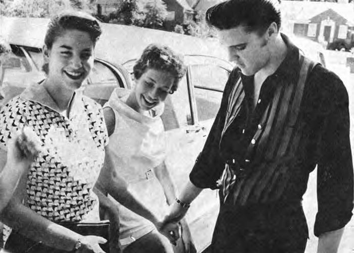 1970 November 14 Elvis candid touching arm of pretty girl another there 2 kinda RARE candid